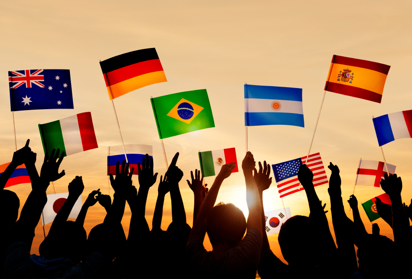 Silhouettes of People Holding Flags From Various Countries